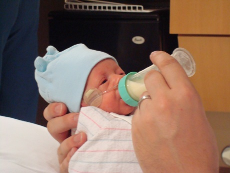 Wes taking his first bottle from daddy - 31 days old