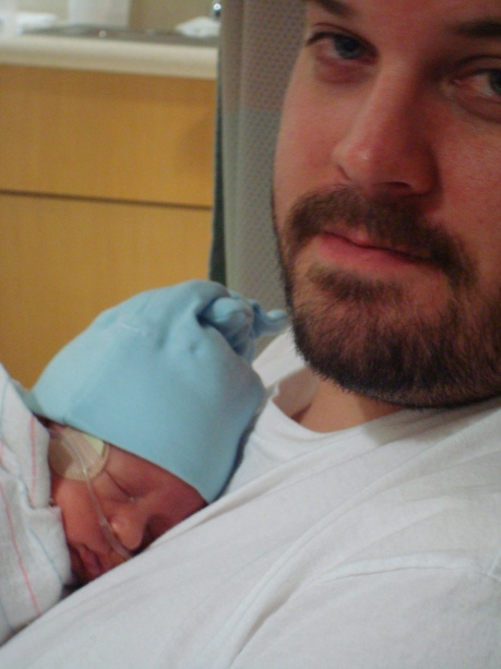 A full and sleepy Weston on daddy's chest