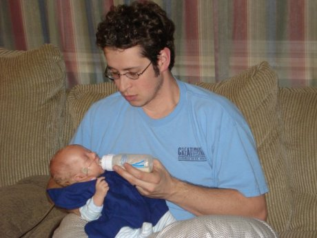 Uncle Joel giving Max his bottle
