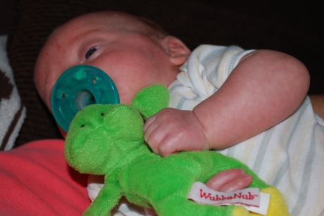 Max cuddling with his Wubbanub (plushie attached to a pacifier)