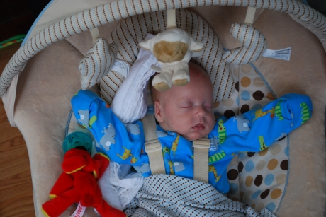 "Wes doing his ""Pope"" pose in the bouncy chair"