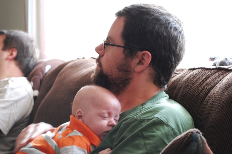 Matt holding a sleeping Max
