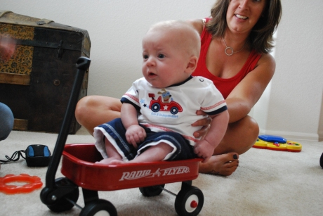 Aunt LeAnn holding Max up in the wagon