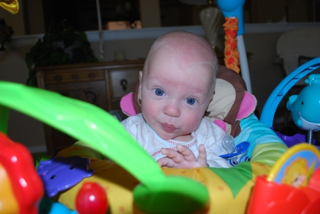 Wes looking a bit like Dr. Evil (Austin Powers) in their new exersaucer